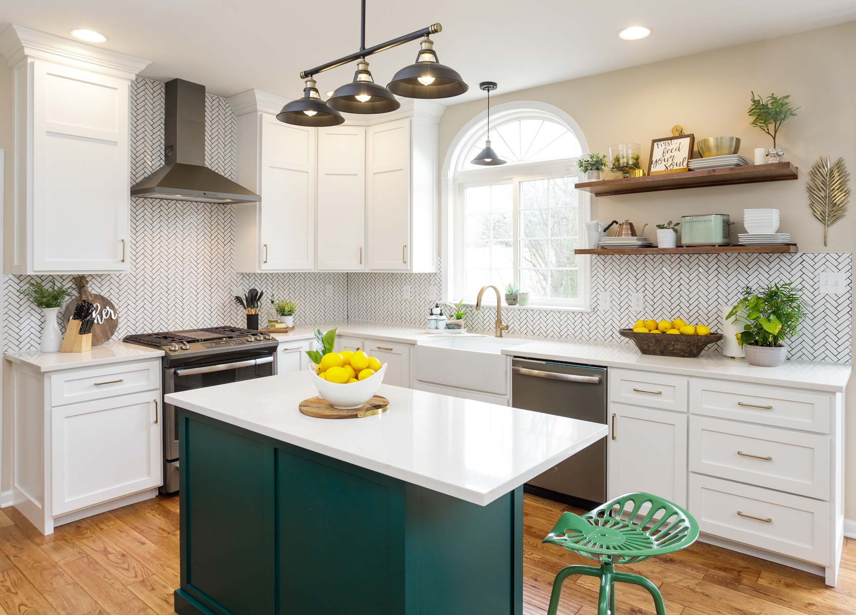 a green kitchen island in a white-painted kitchen