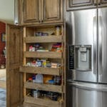 a custom pantry in a large kitchen cabinet