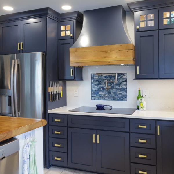 stainless steel fridge in a blue kitchen