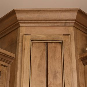 custom woodworking on a corner cabinet