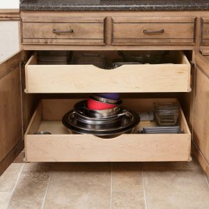 pull-out drawers in a kitchen cabinet